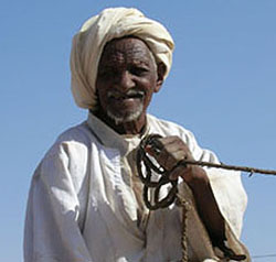 Camel driver in Mygoma, a suburb of Khartoum, Sudan