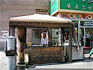 Pix Kebab seller in Urumqi by Jackie Logan