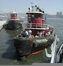 Tugboat rescuing people escaping collapse of Twin Towers on Sept. 11, 2001