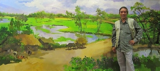 "Muoi Trong Nguyen with his ""Peace"" painting,"